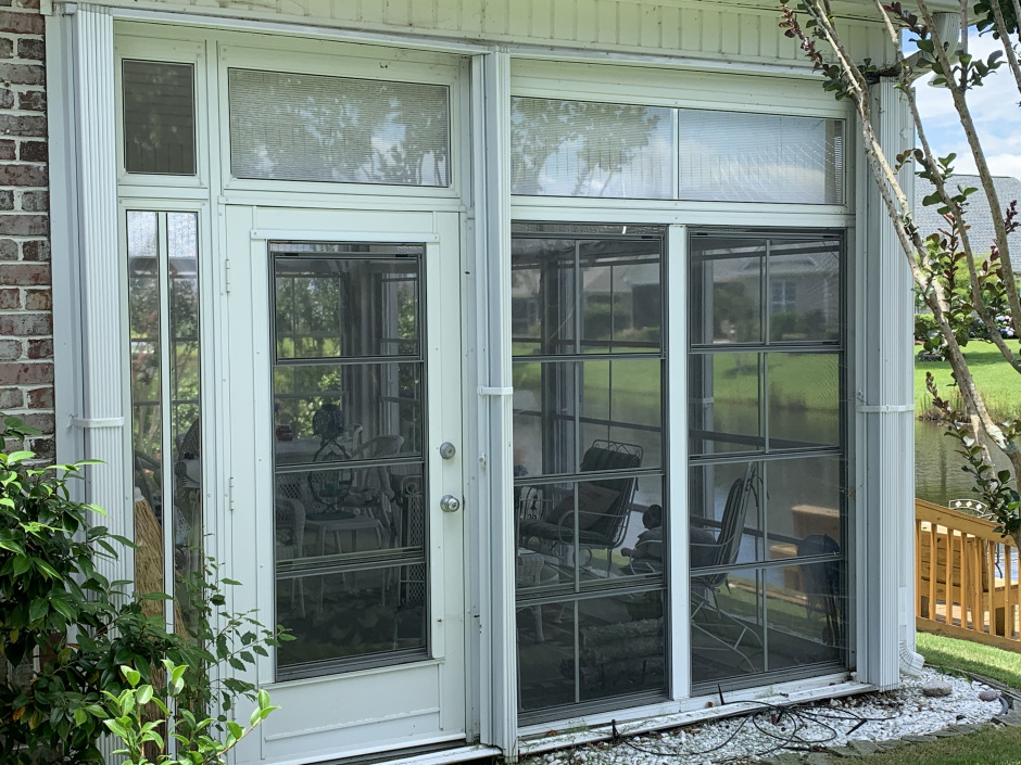 Accordion Shutters for Hurricane Protection on a Home in Leland