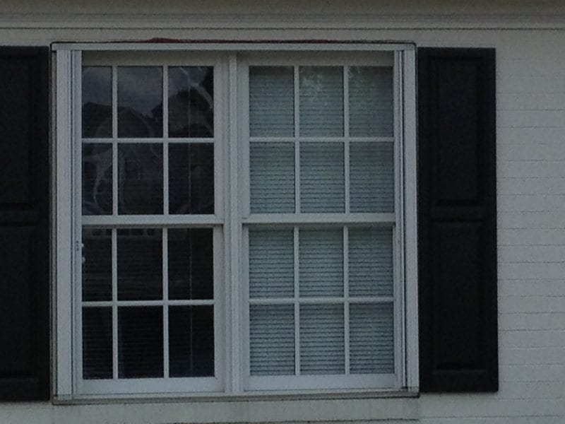 Closeup of Colonial Shutters for Hurricane Protection on the Side of a Home in Wilmington