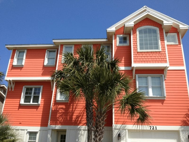 Lexan and Accordion Shutters for Hurricane Protection on the front of an Orange Home at Carolina Beach