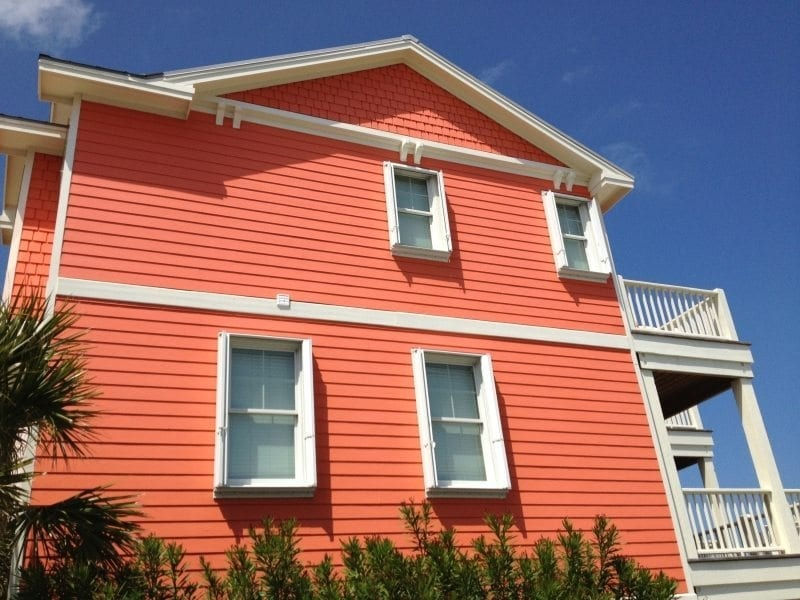 Accordion Shutters for Hurricane Protection on the side of an Orange Home at Carolina Beach