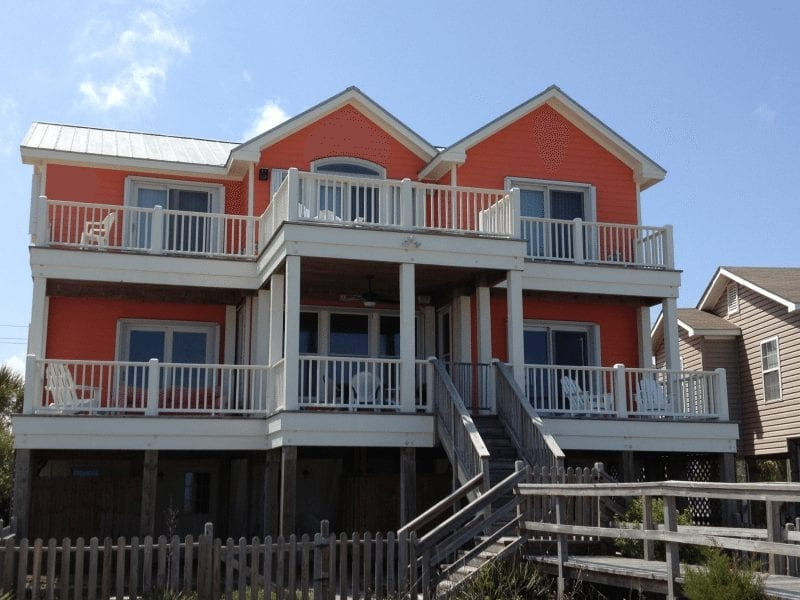 Lexan and Accordion Shutters for Hurricane Protection on the back an Orange Home at Carolina Beach