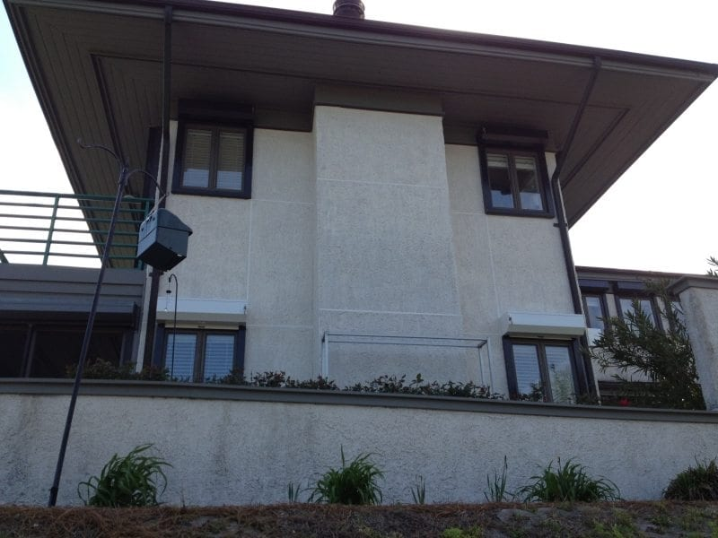 Rolldown Shutters for Hurricane Protection on the porch of a Waterfront Home Near Wilmington